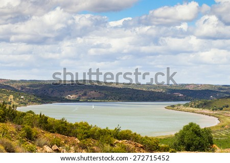 The river Guadiana as seen from Costa Esuri, Ayamonte, Spain on a slightly colour day. - stock photo