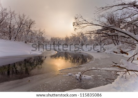 The river in the winter at sunset in Russia on the peninsula of Kamchatka - stock photo