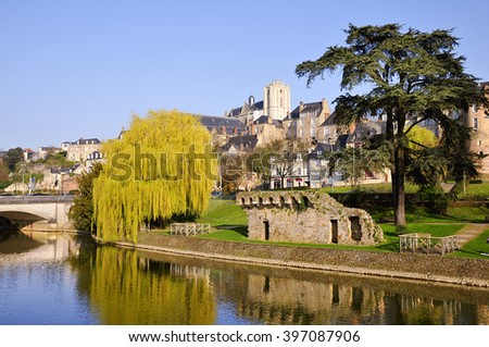 The river Sarthe and weeping willow and the ruins of old fortification at Le Mans of the Pays de la Loire region in north-western France