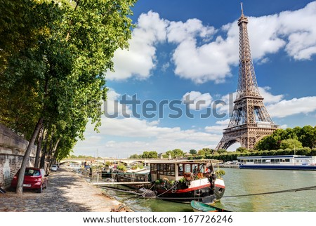 The River Seine with the Eiffel tower in Paris - stock photo