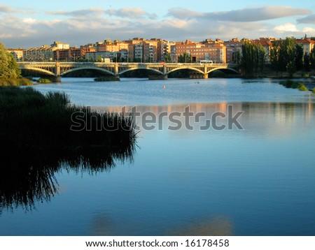 The River Tormes, flowing through Salamanca, Spain - stock photo
