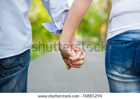 The road ahead, young couple holding hands.