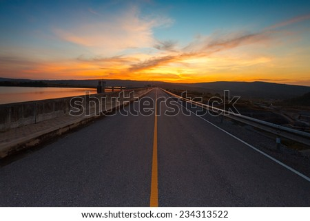The road and colorful sunset - stock photo