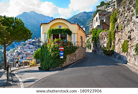 The road branches into two directions, one leads to the scenic village of Positano and beach, another one is intercity road, Amalfi coast, Italy. - stock photo