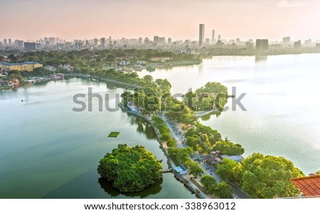 The road crossing the island West lake, Hanoi, Vietnam with green tree-lined streets, temples located between small oasis in sunshine of West Lake and boasts a beautiful evening in capital of Vietnam