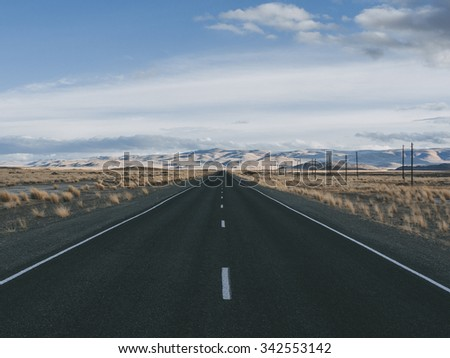 The road disappearing into a desert steppe - stock photo