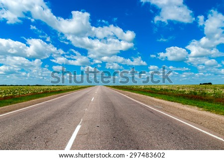 The Road Lies in a Field and Leaves to the Horizon. The Route in Russia - stock photo