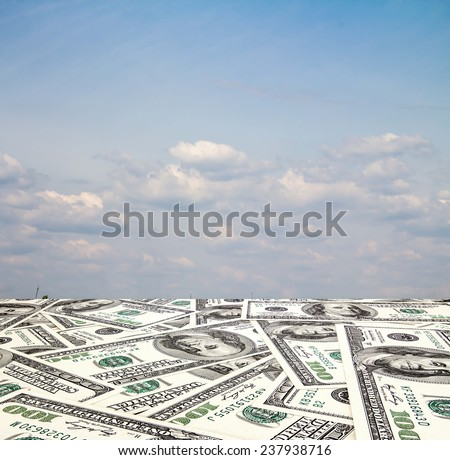 The road out of the dollar in the blue sky with clouds - stock photo