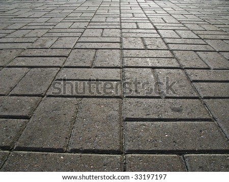 The road surface of concrete blocks - stock photo