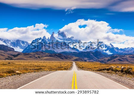 The road through the desert. The highway crosses Patagonia and conducts to snow-covered top of Mount Fitzroy - stock photo