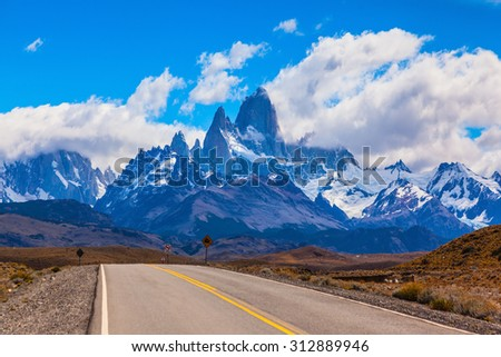 The road through the desert. The highway crosses the Patagonia and leads to the mountains Fitz Roy - stock photo