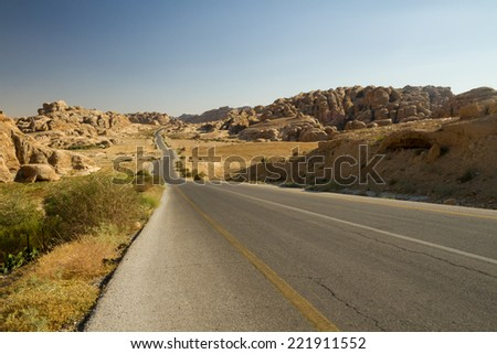The road through the hills from Petra to Little Petra, Jordan. - stock photo