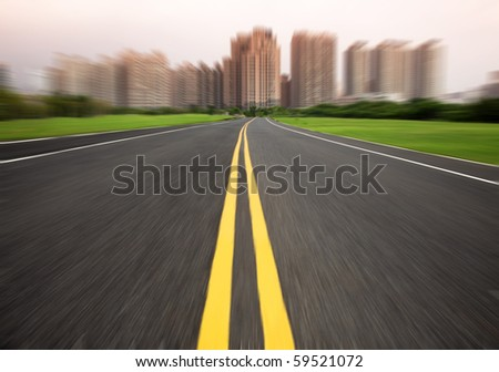 the road to city in motion blur - stock photo
