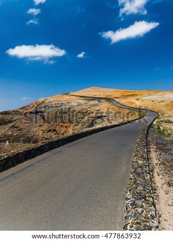 The road to the top of the mountain Mirador del Rio on background blue sky. Lanzarote. Canary Islands. Spain