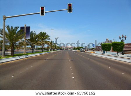 The road with hanging traffic lights to the Marina mall in Abu Dhabi, UAE. - stock photo