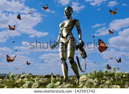 The  robot with a camera and a butterfly on the grass. - stock photo