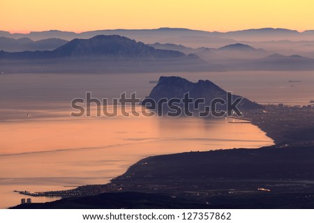 The Rock of Gibraltar and African Coast at sunset - stock photo