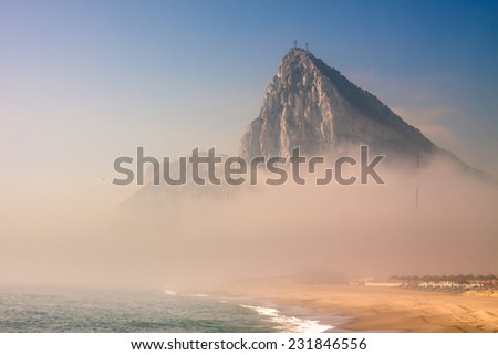 The Rock of Gibraltar in foggy morning. - stock photo