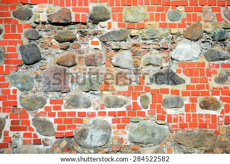 The rocks and bricks old Vilnius defense wall background. - stock photo