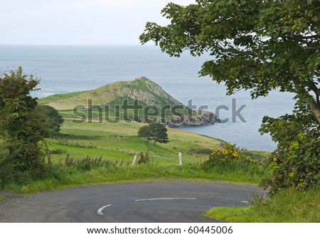 The rocky cliffs of Torr head, County Antrim, Northern Ireland, point out towards the Atlantic on a sunny day in early autumn. - stock photo