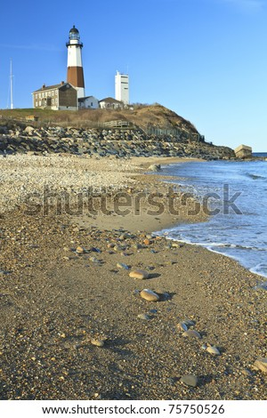 The rocky gravel beach below Montauk Lighthouse at the tip of  Long Island, NY - stock photo