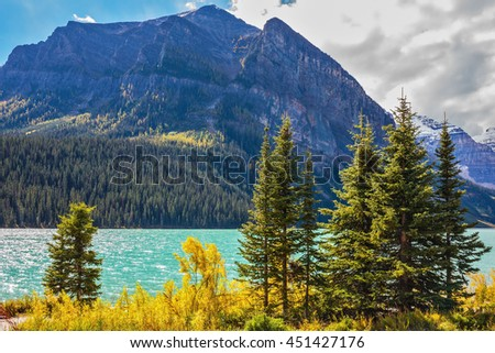 The Rocky Mountains, Canada, Banff National Park. The magnificent lake Louise in an environment of glaciers. Excellent sunny day - stock photo