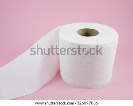 The roll of white tissue toilet paper. - stock photo