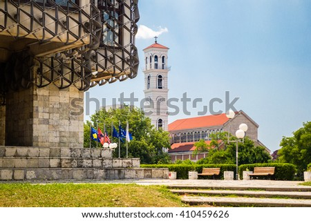 The Roman Catholic Cathedral of Blessed Mother Teresa view from National Public Library in Pristina, Kosovo - stock photo