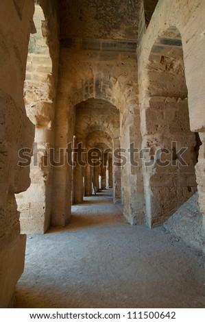 The Roman Colosseum in El Djem is one of the largest Colosseums. This is one of galleries that  rounds up the audience space. - stock photo
