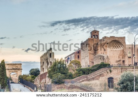 The Roman Forum (Foro Romano) a rectangular forum (plaza) surrounded by the ruins of several important ancient government buildings at the center of the city of Rome in Italy. - stock photo