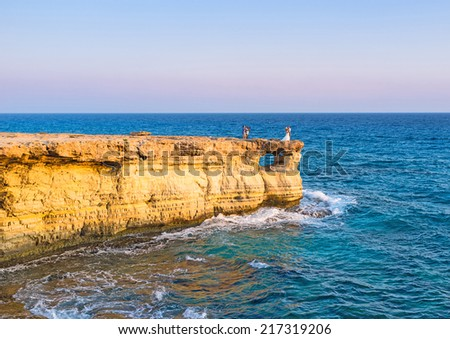 The romantic photo session on the slope of Cavo Greco, Cyprus. - stock photo