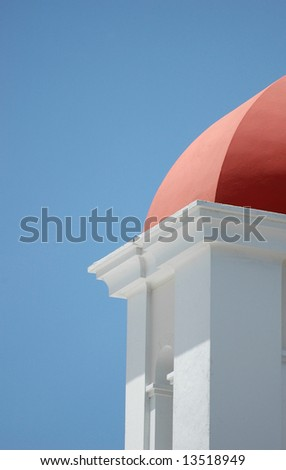 The roof of a small building at Castillo El Morro in San Juan, Puerto Rico contrasts with a pure blue Caribbean sky - stock photo