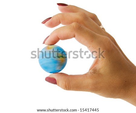 The rotating globe in a hand the woman - stock photo