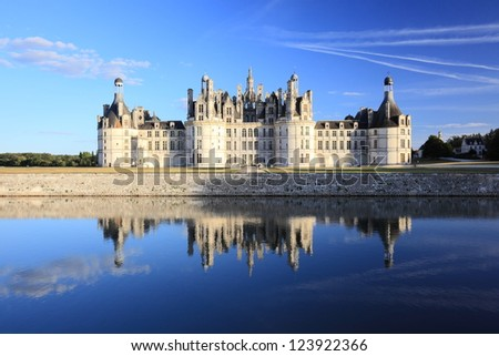 The royal chateau de Chambord and reflection - stock photo