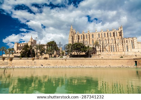 the Royal Palace of La Almudaina and the Cathedral of Santa Maria of Palma, Mallorca, Spain - stock photo