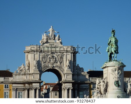 The rue Augusta arch and the statue of Sao Jorge in Lisbon in Portugal - stock photo