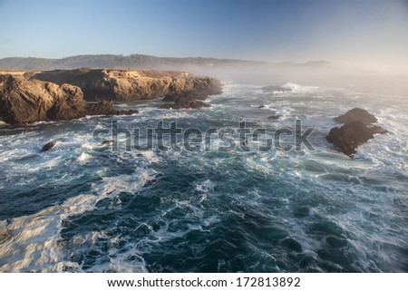 The rugged northern California coastline in Mendocino is one of the most scenic areas along the west coast. Highway 1 runs right along the shore and provides gorgeous views of the Pacific ocean. - stock photo