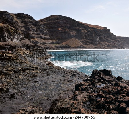 The rugged volcanic coastline and shores of the island of Fogo, Part of the archipelago of Cape Verde off the west coast of Africa - stock photo