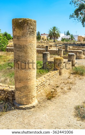The ruined stone columns at the archaeological museum of El Jem, Tunisia. - stock photo