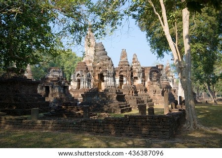 The ruins of an ancient Buddhist temple Wat Chedi Ched Thaye. Si Satchanalai Historical Park, Thailand - stock photo