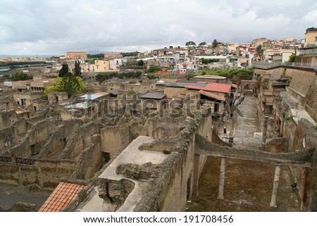 The ruins of Herculaneum, covered by the eruption of Vesuvius in 79AD, in Southern Italy, uncovered under the modern city of Ercolano. - stock photo