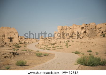 The Ruins of Jiaohe is located near Turpan City,Xinjiang,China . It is a well-known ancient city with a history more than 2,000 years along the Silk Road. - stock photo