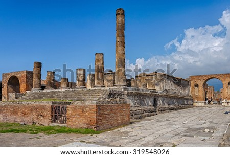 The ruins of Pompeii, destroyed by the eruption of Mount Vesuvius. Italy. View of the ruins of the Temple of Jupiter with two triumphal arches.  - stock photo