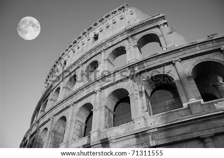 The ruins of the Colosseum in Rome at night, Italy. - stock photo