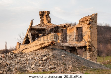 The ruins of the destroyed building in the Makeevka Donetsk region - stock photo