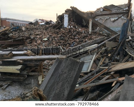 The ruins of the old house. Construction waste, demolition of permanent structures.