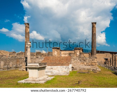 The ruins of the temple of Apollo in Pompeii. Volcano Vesuvius in the background - stock photo