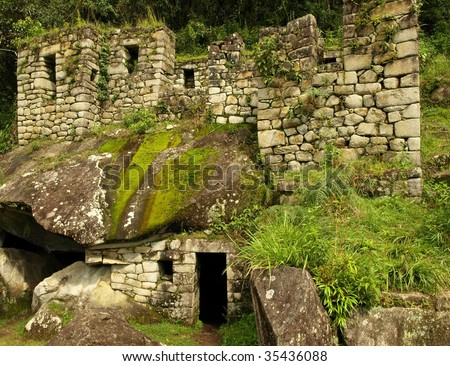 The ruins of the Temple of the Moon at the bottom of Wayna Picchu, built by the ancient Inca. Machu Picchu, Peru, South America. - stock photo