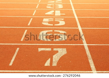 The running race track number screen on ground surface represent the sport concept related idea. - stock photo