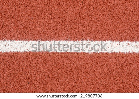 The running track rubber lanes cover texture with line for background. - stock photo